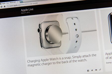 keynote: PARIS, FRANCE - MAR 9, 2015: Apple Computers event keynote tweets close up seen on iMac display featuring magnetic charger for Apple Watch as seen on 9 March, 2015