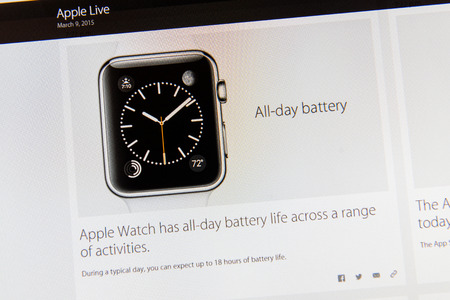 tweets: PARIS, FRANCE - MAR 9, 2015: Apple Computers event keynote tweets close up seen on iMac dislay featuring battery state of Apple Watch as seen on 9 March, 2015