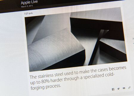 PARIS, FRANCE - MAR 9, 2015: Apple Computers event keynote tweets close up seen on iMac screen with stainless steel used to make Apple Watch cases as seen on 9 March, 2015