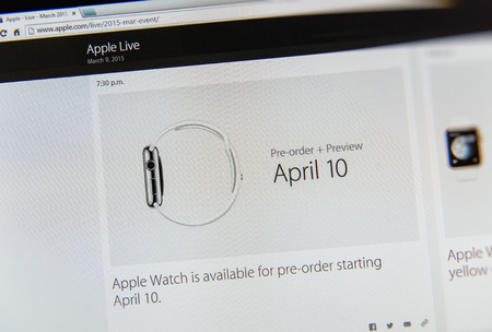 PARIS, FRANCE - MAR 9, 2015: Apple Computers event keynote tweets close up seen on iMac display with preorder date for Apple Watch - 10 April as seen on 9 March, 2015