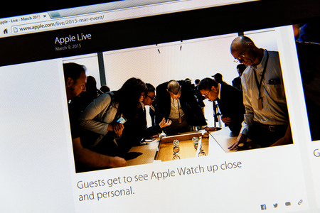 keynote: PARIS, FRANCE - MAR 9, 2015: Apple Computers event keynote tweets close up seen on iMac display with guests admiring new Apple Watch as seen on 9 March, 2015