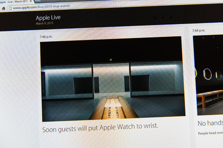 keynote: PARIS, FRANCE - MAR 9, 2015: Apple Computers event keynote tweets close up seen on iMac display with text Soon guests will put Apple Watch to wirst as seen on 9 March, 2015 Editorial