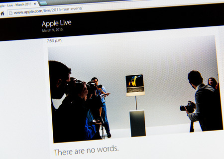 keynote: PARIS, FRANCE - MAR 9, 2015: Apple Computers event keynote tweets close up seen on iMac display with There are no words and new MacBook on stand as seen on 9 March, 2015