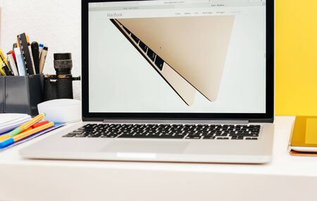 apple computers: PARIS, FRANCE - MAR 10, 2015: Apple Computers website on MacBook Retina in room environment showcasing golden MacBook as seen on 10 March, 2015