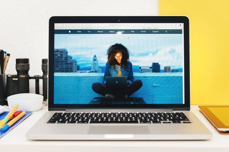apple computers: PARIS, FRANCE - MAR 10, 2015: Apple Computers website on MacBook Retina in room environment showcasing MacBook dedicated page as seen on 10 March, 2015