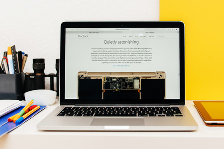 apple computers: PARIS, FRANCE - MAR 10, 2015: Apple Computers website on MacBook Retina in room environment showcasing how quiet is new MacBook as seen on 10 March, 2015