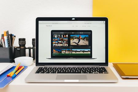 apple computers: PARIS, FRANCE - MAR 10, 2015: Apple Computers website on MacBook Retina in room environment showcasing new MacBook iMovie app as seen on 10 March, 2015