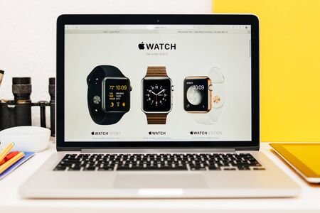 apple computers: PARIS, FRANCE - MAR 10, 2015: Apple Computers website on MacBook Retina in room environment showcasing Apple Watch Range as seen on 10 March, 2015