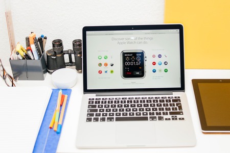apple computers: PARIS, FRANCE - MAR 10, 2015: Apple Computers website on MacBook Retina in room environment showcasing Chronograph App on Apple Watch as seen on 10 March, 2015