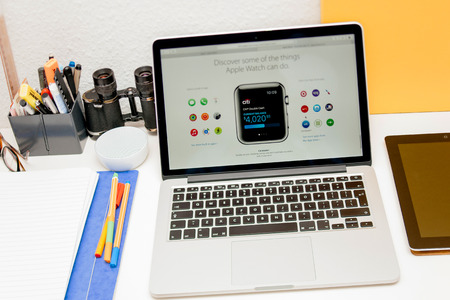 apple computers: PARIS, FRANCE - MAR 10, 2015: Apple Computers website on MacBook Retina in room environment showcasing CITI Bank app on Apple Watchas seen on 10 March, 2015 Editorial