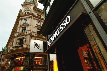 nestle: VIENNA, AUSTRIA - JULY 47, 2011: Close-up of the Nespresso logo on the frontage of the Nespresso store at the Graben shopping street in Vienna, Austria. Nespresso is the brand name of Nestlé Nespresso S.A., an operating unit of the Nestlé Group, based i