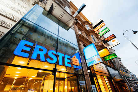 bank branch: VIENNA, AUSTRIA - JULY 4, 2011: The Erste bank logo sits on display outside a bank branch, operated by Erste Group Bank AG, in Vienna, Austria. Austrias economy, reliant on exports to other European Union countries, isnt growing fast enough to reduce th