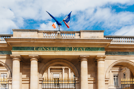 constitutional: Conseil dEtat - Council of State building with French flag and Europena Union Flag in Paris France. Council of State is a body of the French national government that acts both as legal adviser of the executive branch and as the supreme court for administ