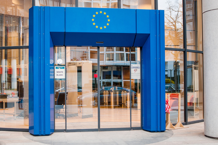 security code: STRASBOURG, FRANCE - MARCH 24, 2015: Entrance to Council of Europe European Union with blue gate and European Union Stars logo above and white security code badge on the door. Editorial