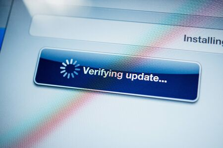 verifying: Verifying update text message on digital tablet screen Editorial