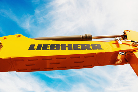 making earth: FRANKFURT, GERMANY - SEPTEMBER 05, 2014: LIEBHERR hydraulic excavator arm - industrial equipment as seen on construction site. By 2007, it was the worlds largest crane company. Editorial