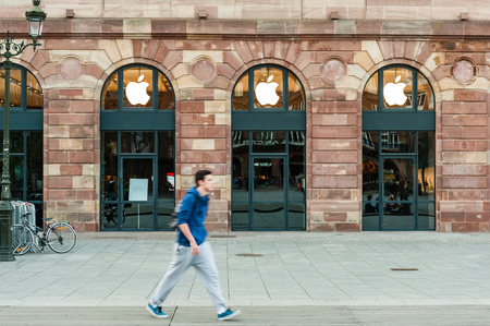 rearrangement: Man passing in front of Apple Store which has the shopping windows covered with black fabric curtains to protect the store rearrangement for the Apple Watch launch. Apples Watch with goes on sale in US, Europe and Asia on April 10