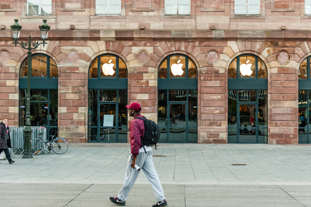 Man walking in front of Apple Store facade with covered shopping windows with black fabric curtains to protect the store rearrangement for the Apple Watch launch. Apples Watch with goes on sale in US, Europe and Asia on April 10 Editorial