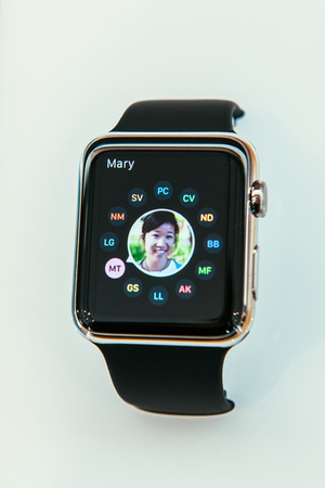 capabilities: PARIS, FRANCE – APR 10, 2014: New wearable computer Apple Watch smartwatch displaying the new Contact App . It incorporates fitness tracking and health-oriented capabilities and  integration with iOS Apple products and services