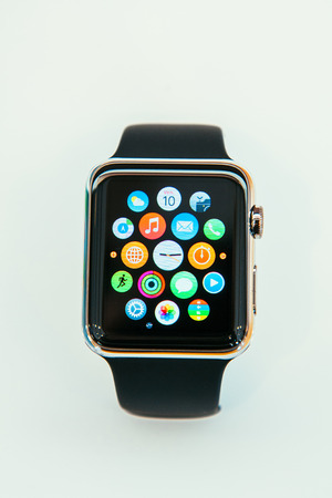 luxury watches: PARIS, FRANCE – APR 10, 2014: New wearable computer Apple Watch smartwatch displaying the new interface home screen. It incorporates fitness tracking and health-oriented capabilities and  integration with iOS Apple products and services