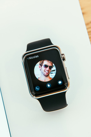 PARIS, FRANCE – APR 10, 2014: New wearable computer Apple Watch smartwatch displaying the new Contact App. Apple Watch incorporates fitness tracking and health-oriented capabilities and  integration with iOS Apple products and services