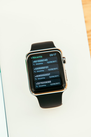 incorporates: PARIS, FRANCE – APR 10, 2015: New wearable computer Apple Watch smartwatch displaying the new Calling App. Apple Watch incorporates fitness tracking and health-oriented capabilities and  integration with iOS Apple products and services