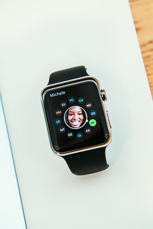 incorporates: PARIS, FRANCE – APR 10, 2014: New wearable computer Apple Watch smartwatch displaying the new Contact App. Apple Watch incorporates fitness tracking and health-oriented capabilities and  integration with iOS Apple products and services