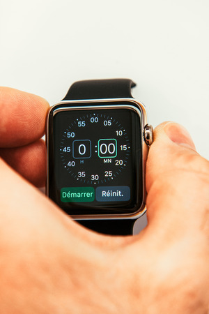 PARIS, FRANCE – APR 10, 2015: New wearable computer Apple Watch smartwatch displaying the new Chronometer App. Apple Watch incorporates fitness tracking and health-oriented capabilities and  integration with iOS Apple products and services Editorial