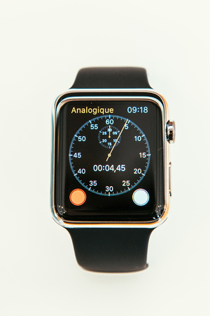 watch: PARIS, FRANCE – APR 10, 2015: New wearable computer Apple Watch smartwatch displaying the new Chronometer App. Apple Watch incorporates fitness tracking and health-oriented capabilities and  integration with iOS Apple products and services Editorial