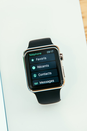 incorporates: PARIS, FRANCE – APR 10, 2015: New wearable computer Apple Watch smartwatch displaying the new Phone App. Apple Watch incorporates fitness tracking and health-oriented capabilities and  integration with iOS Apple products and services