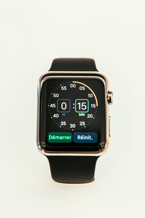 incorporates: PARIS, FRANCE – APR 10, 2015: New wearable computer Apple Watch smartwatch displaying the new Chronometer App. Apple Watch incorporates fitness tracking and health-oriented capabilities and  integration with iOS Apple products and services Editorial