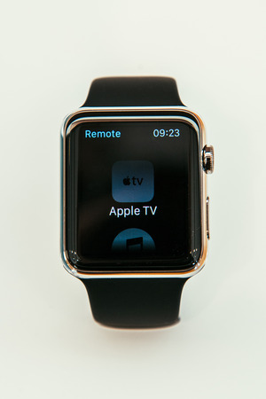 incorporates: PARIS, FRANCE – APR 10, 2015: New wearable computer Apple Watch smartwatch displaying the new Remmote App. Apple Watch incorporates fitness tracking and health-oriented capabilities and  integration with iOS Apple products and services