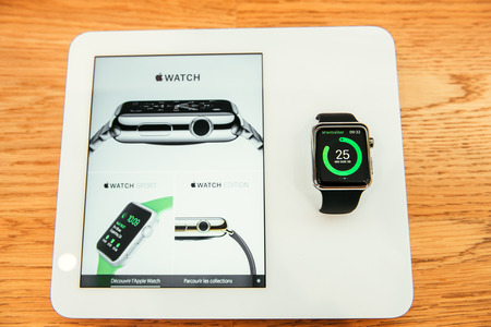 incorporates: PARIS, FRANCE – APR 10, 2015: New wearable computer Apple Watch smartwatch displaying the new Sport Edition. Apple Watch incorporates fitness tracking and health-oriented capabilities and  integration with iOS Apple products and services