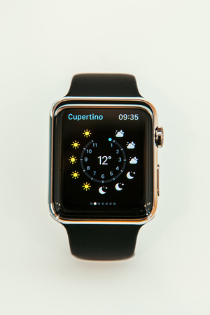 PARIS, FRANCE – APR 10, 2015: New wearable computer Apple Watch smartwatch displaying the new Weather App. Apple Watch incorporates fitness tracking and health-oriented capabilities and  integration with iOS Apple products and services