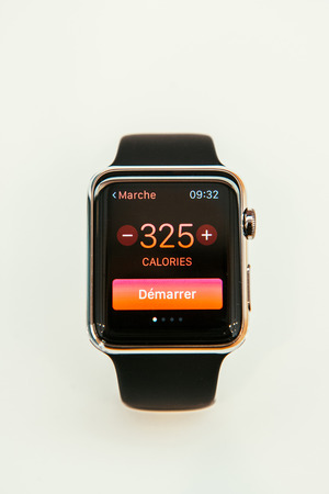 incorporates: PARIS, FRANCE – APR 10, 2015: New wearable computer Apple Watch smartwatch displaying the new Health and Fitness App Apple Watch incorporates fitness tracking and health-oriented capabilities and  integration with iOS Apple products and services Editorial
