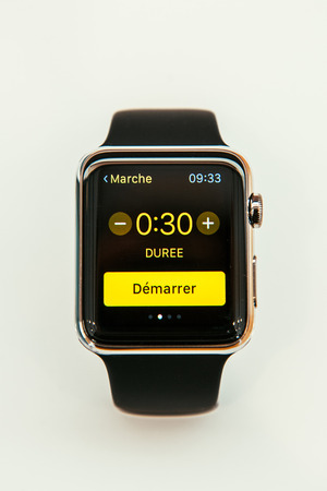 incorporates: PARIS, FRANCE – APR 10, 2015: New wearable computer Apple Watch smartwatch displaying the new Health and Fitness App Apple Watch incorporates fitness tracking and health-oriented capabilities and  integration with iOS Apple products and services