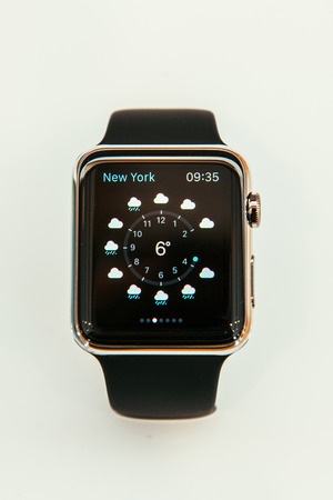 capabilities: PARIS, FRANCE – APR 10, 2015: New wearable computer Apple Watch smartwatch displaying the new Weather App. Apple Watch incorporates fitness tracking and health-oriented capabilities and  integration with iOS Apple products and services Editorial