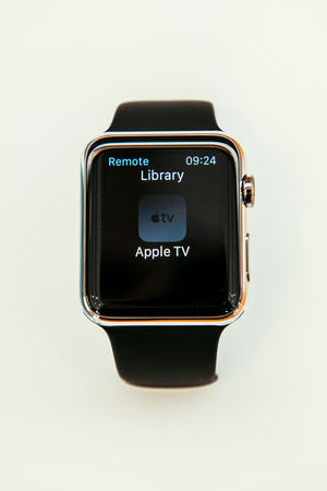 PARIS, FRANCE – APR 10, 2015: New wearable computer Apple Watch smartwatch displaying the new Remmote App. Apple Watch incorporates fitness tracking and health-oriented capabilities and  integration with iOS Apple products and services