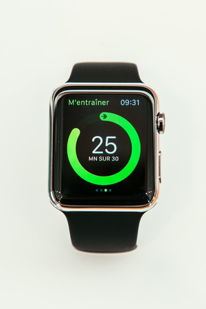 watch: PARIS, FRANCE – APR 10, 2015: New wearable computer Apple Watch smartwatch displaying the new Health App. Apple Watch incorporates fitness tracking and health-oriented capabilities and  integration with iOS Apple products and services