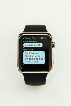 incorporates: PARIS, FRANCE – APR 10, 2015: New wearable computer Apple Watch smartwatch displaying the new Messages App. Apple Watch incorporates fitness tracking and health-oriented capabilities and  integration with iOS Apple products and services