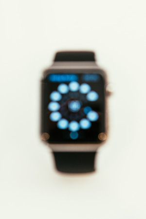 incorporates: PARIS, FRANCE – APR 10, 2015: New wearable computer Apple Watch smartwatch displaying the new  . Apple Watch incorporates fitness tracking and health-oriented capabilities and  integration with iOS Apple products and services