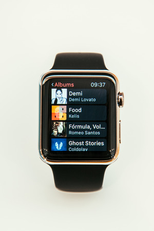 PARIS, FRANCE – APR 10, 2015: New wearable computer Apple Watch smartwatch displaying the new Music App. Apple Watch incorporates fitness tracking and health-oriented capabilities and  integration with iOS Apple products and services
