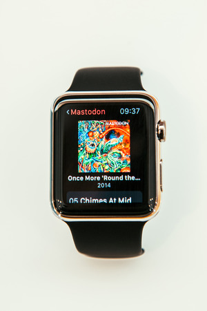 incorporates: PARIS, FRANCE – APR 10, 2015: New wearable computer Apple Watch smartwatch displaying the new Music App. Apple Watch incorporates fitness tracking and health-oriented capabilities and  integration with iOS Apple products and services
