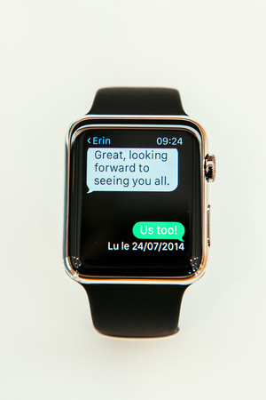 capabilities: PARIS, FRANCE – APR 10, 2015: New wearable computer Apple Watch smartwatch displaying the new Message App . Apple Watch incorporates fitness tracking and health-oriented capabilities and  integration with iOS Apple products and services