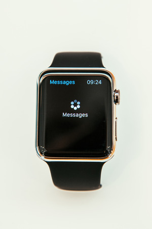 incorporates: PARIS, FRANCE – APR 10, 2015: New wearable computer Apple Watch smartwatch displaying new Message App open process. Apple Watch incorporates fitness tracking and health-oriented capabilities and  integration with iOS Apple products and services