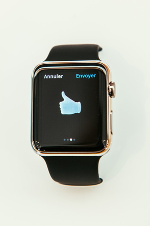incorporates: PARIS, FRANCE – APR 10, 2015: New wearable computer Apple Watch smartwatch displaying the new Deal OK Sign. Apple Watch incorporates fitness tracking and health-oriented capabilities and  integration with iOS Apple products and services Editorial