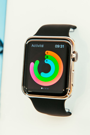 capabilities: PARIS, FRANCE – APR 10, 2015: New wearable computer Apple Watch smartwatch displaying the new Health App. Apple Watch incorporates fitness tracking and health-oriented capabilities and  integration with iOS Apple products and services