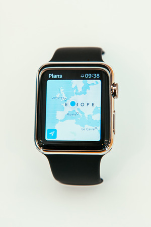 PARIS, FRANCE – APR 10, 2015: New wearable computer Apple Watch smartwatch displaying the new Maps App. Apple Watch incorporates fitness tracking and health-oriented capabilities and  integration with iOS Apple products and services