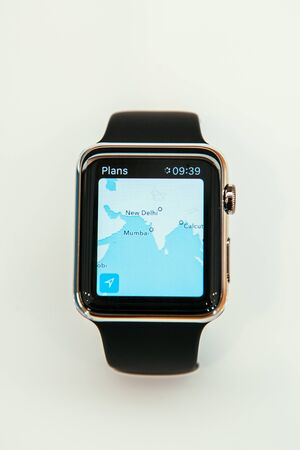 capabilities: PARIS, FRANCE – APR 10, 2015: New wearable computer Apple Watch smartwatch displaying the new Maps App. Apple Watch incorporates fitness tracking and health-oriented capabilities and  integration with iOS Apple products and services
