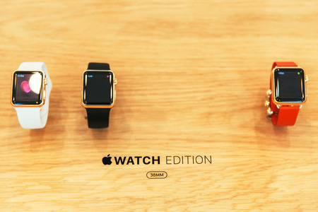 PARIS, FRANCE – APR 10, 2015: New wearable computer Apple Watch smartwatch displaying the Edition gold collection. Apple Watch incorporates fitness tracking and health-oriented capabilities and  integration with iOS Apple products and services